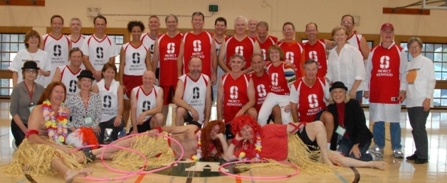 "Classmates and friends raising funds for Project Redwood at the 2010 Basketball Bonanza. Standing: Beth Gibson Sawi, Dick Boyce, Larry Cerf, Jeff Chambers, Ros Gold-Onwude, Bob Kagle, Steve Kelly, Don Wood, Doug Kaewart, Miles White, Matt Holve, Randy Blair, Jon Hamren, Scott Lochridge, Carol Head, Mike Child, Ed Kaufman, Donna Allen; Kneeling: Elizabeth Strawn Gage, Nick Farwell, Ann Thoke Espy, Martha Gilmore, Charlie Baum, Joe Hamby, Doug Burgum, Chip Adams, Amy Kommer Minella, Stan Kinsey, Kristi Smith-Hernandez; Hula ""Girls"": Bob Baldwin, Phil Jonckheer, Ken Moch"