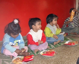 Children receive a treat from out-of-town visitors (the David Fletcher family) at HOPE worldwide orphanage in New Delhi.