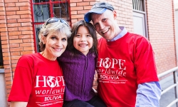 HOPE worldwide Bolivia program leaders Noelle and Kevin Broyles (with a young Bolivian).