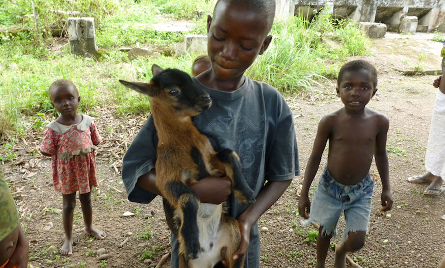globalaction boy with goat