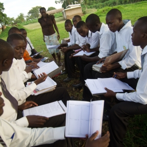 Ugandan High school students in an Educate! leadership and entrepreneurship program meet with their mentor.